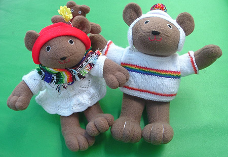 the little bears are wearing rainbow stripes.